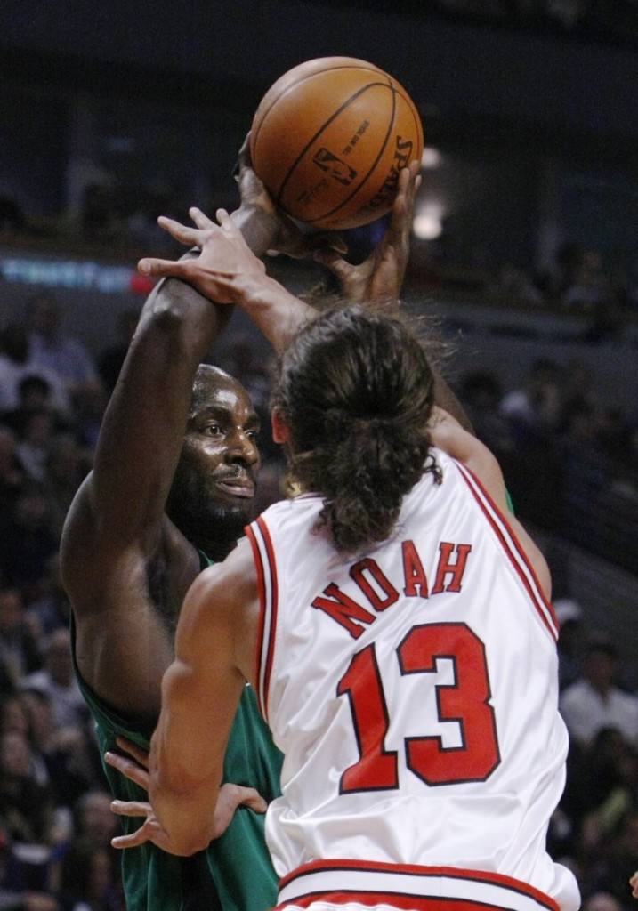 Joakim Noah of the Chicago Bulls pressures Kevin Garnett of the Boston Celtics during the first half of their game Tuesday night. The Bulls earned a 101-93 victory.