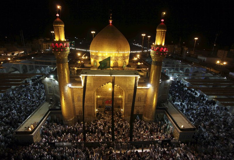 The Associated Press One line for cutline goes to book asjfl;kjasd FILE - In this Thursday, Sept. 10, 2009 file photo, Shiites gather at the holy shrine of Imam Ali to mark the last days of the Muslim holy month of Ramadan in Najaf, 160 kilometers (100 miles) south of Baghdad, Iraq. Iraqi and U.S. security officials say Iraqi forces have disrupted an al-Qaida plot to hijack airliners and fly them into Shiite holy shrines. They say the plan was to carry out a 9/11-style attack aimed at re-igniting sectarian violence in Iraq. (AP Photo/Alaa Al-Marjani, File)lk;fkjasdl;kjf