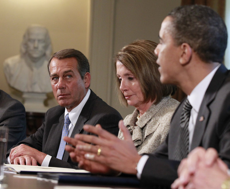 House Minority Leader John Boehner, R-Ohio, listens Wednesday at the White House as President Obama and congressional leaders discuss an overhaul of regulations that govern how Wall Street operates. Between them is House Speaker Nancy Pelosi, D-Calif.