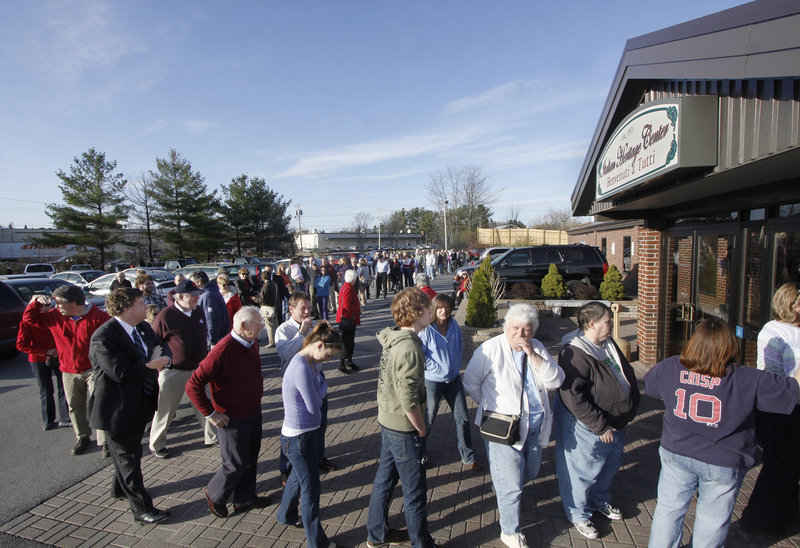 A line forms outside the Italian Heritage Center in Portland, where Gov. Baldacci hosted a spaghetti supper to benefit Preble Street on Wednesday. The event was a response to a move by the Catholic Church, which said it was withdrawing funding because of Preble Street's support of a same-sex marriage ballot question.
