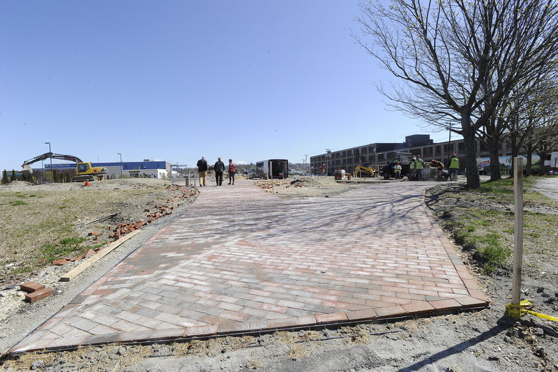 A brick walkway at Preble Street marks an under-construction section of the trail.