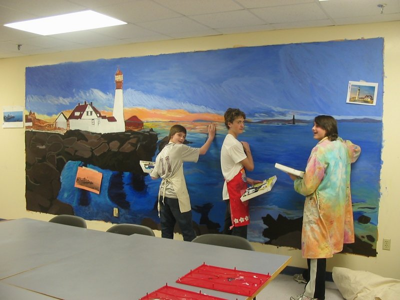 Cape Elizabeth Middle School students, from left, Josh Grassele, Trevor Gale and Austin Andrew work to complete a mural of Portland Head Light before Arts Night.