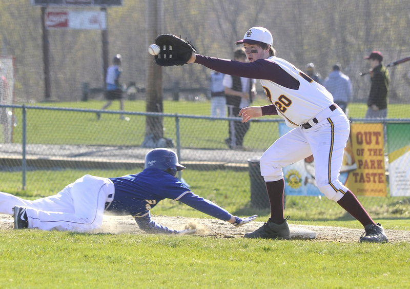 Falmouth's Dillon Dresser dives back safely to first base as Will Pierce of Cape Elizabeth fields the pickoff attempt Thursday. Cape won, 4-2.