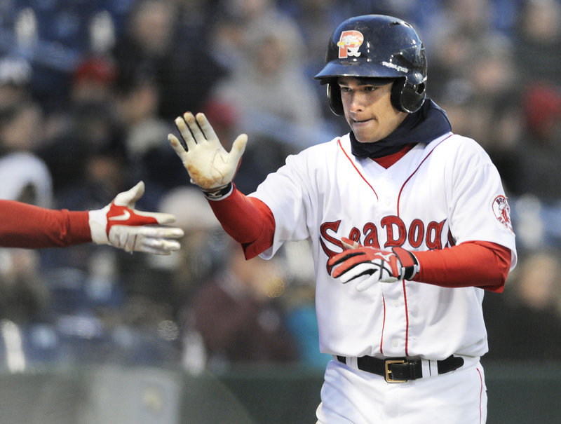 Jose Iglesias of the Portland Sea Dogs is greeted Thursday night after scoring in the fifth inning against the Trenton Thunder in the home opener at Hadlock Field. Iglesias doubled – the first Portland hit of the game – and scored on Jason Place's single.