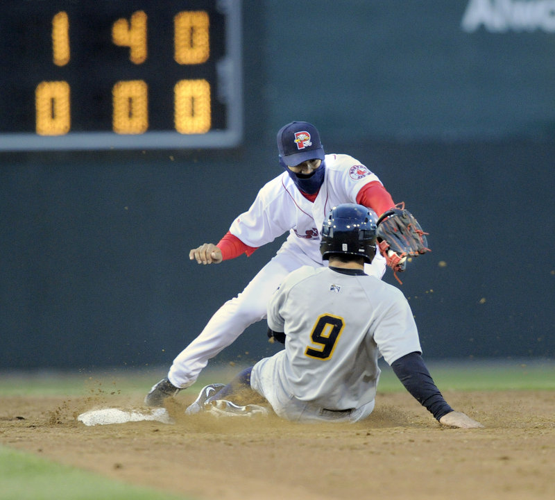 Austin Krum of the Trenton Thunder is forced at second as shortstop Jose Iglesias takes the throw in the fifth inning.