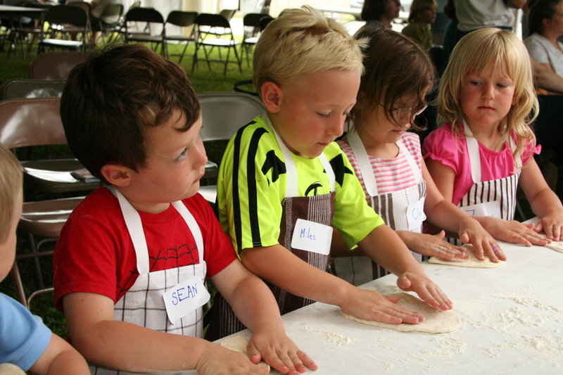 Children prepare dough for pizza at a workshop during last year's Artisan Bread Fair following the Kneading Conference in Skowhegan. This year's event, July 29-31, has been moved to the Skowhegan Fairgrounds to accommodate more participants.