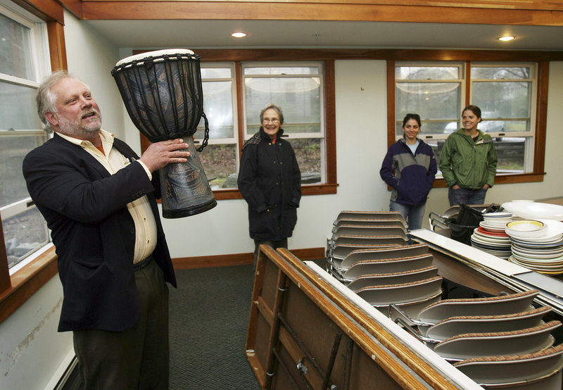 The Rev. Larry Brickner-Wood, pastor of the United Campus Ministry, holds up a drum in Durham, N.H., Friday. The building re-opened after a four-month closing to clean for anthrax.