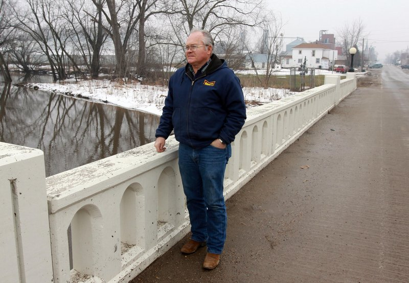 Chelsea, Iowa, Mayor Roger Ochs looks over Otter Creek in Chelsea on March 9. Chelsea's 297 residents were tempted to move after 2008's flood but ultimately opted to stay put.