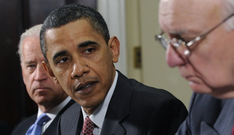 President Obama looks to Paul Volcker, chairman of the President's Economic Recovery Advisory Board, as Vice President Joe Biden looks on at left, on Friday during a meeting at the White House. The White House is preparing a major financial system overhaul.