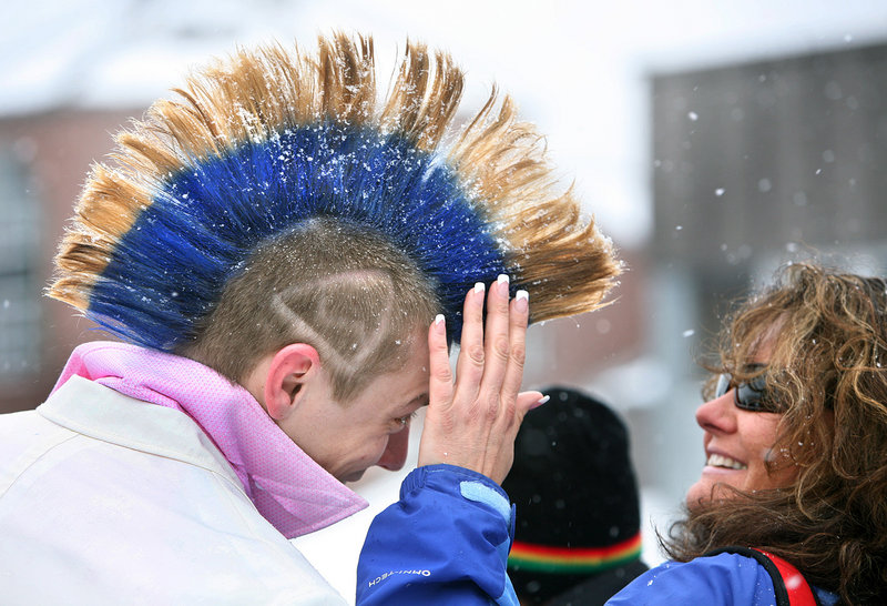 Mary Mason of Naples checks out the mohawk Chris Heal of Epping, N.H., has been growing for nine months to have it ready for the Bud Light Reggae Fest at Sugarloaf in Carrabassett Valley. Heal says that after the festival he''ll shave it off and start growing it again for next year.