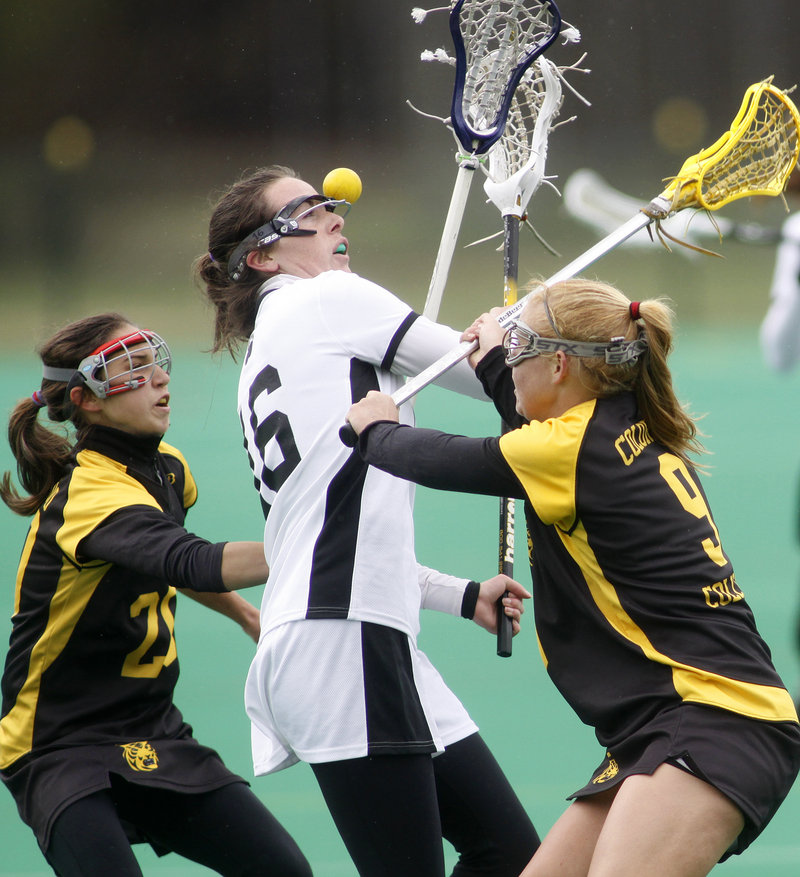 Helen Conaghan of Bowdoin, center, loses control of the ball while defended by Colorado College's Gioia Garden, left, and Hollis Moore during Bowdoin's 17-3 women's lacrosse victory Saturday at Brunswick.