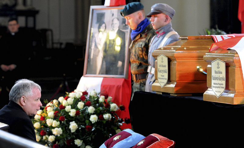 Poland''s former prime minister Jaroslaw Kaczynski, also twin brother of the late President Lech Kaczynski, kneels before the coffins of his brother and first lady Maria Kaczynska during a service at the Warsaw Cathedral in Poland Saturday.