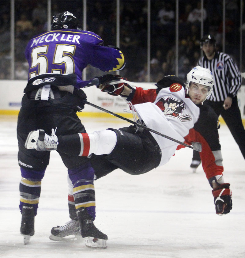 David Meckler of the Monarchs levels Portland's T.J. Brennan in the second period. Manchester lost 7 of 10 to the Pirates in the regular season.