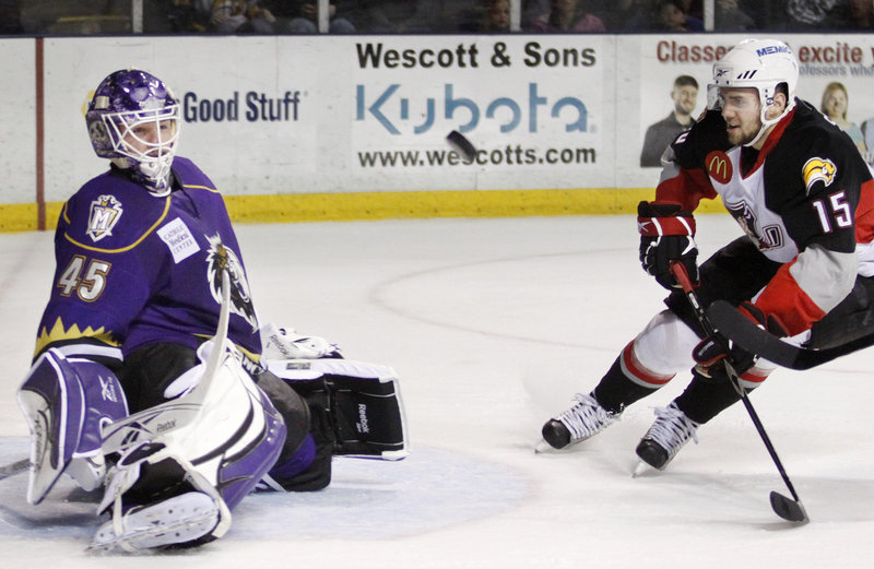 Manchester goalie Jonathan Bernier blocks a shot as Portland's Felix Schutz cruises in looking for a rebound opportunity during their playoff game Saturday night at the Cumberland County Civic Center. The Monarchs beat the Pirates 3-1 for a 2-0 series lead.