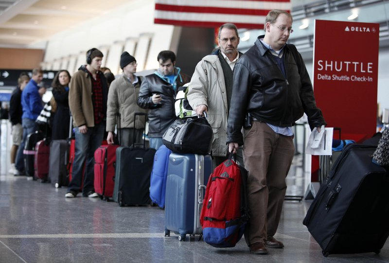 Passengers on airlines other than Spirit won't be paying carry-on fees, but Spirit CEO Ben Baldanza argues that his fare discounts more than offset the carry-on fee.