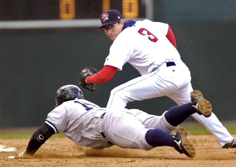 Portland's Nate Spears tags out Trenton's Austin Romine at second base Sunday afternoon at Hadlock Field. The Sea Dogs split their doubleheader with the Thunder, losing the opener 3-1 before winning the second game, 2-1.