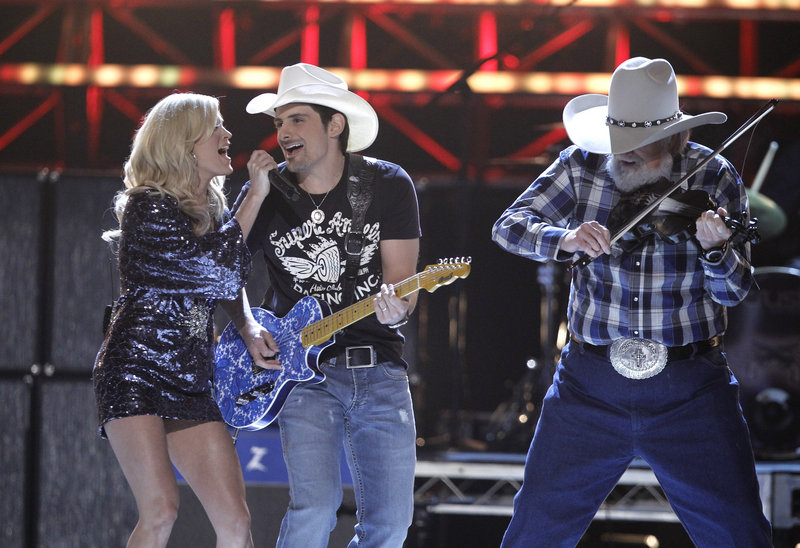 The Associated Press Carrie Underwood, Brad Paisley and Charlie Daniels perform at the Academy of Country Music Awards at the MGM Grand in Las Vegas on Sunday.
