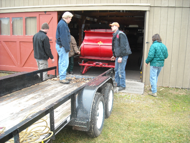 Staffers at 19th Century Historic Willowbrook Village move pieces of their carriage display from a loft in the Durgin Barn. Many of the carriages, sleigh and other pieces of equipment will be auctioned off on May 8 to help the museum enhance and preserve its core exhibit items.