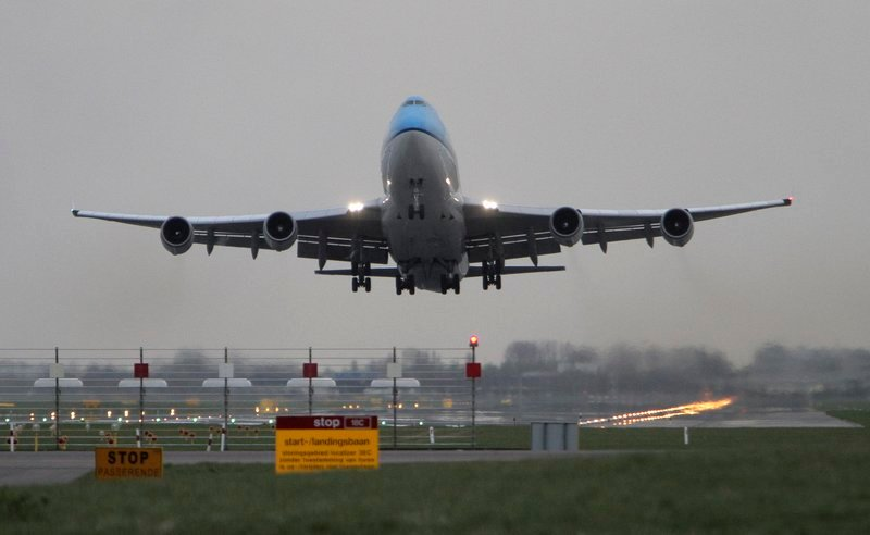 A KLM jetliner, operating under visual flight rules due to ash from an Icelandic volcano, takes off Monday in Amsterdam.