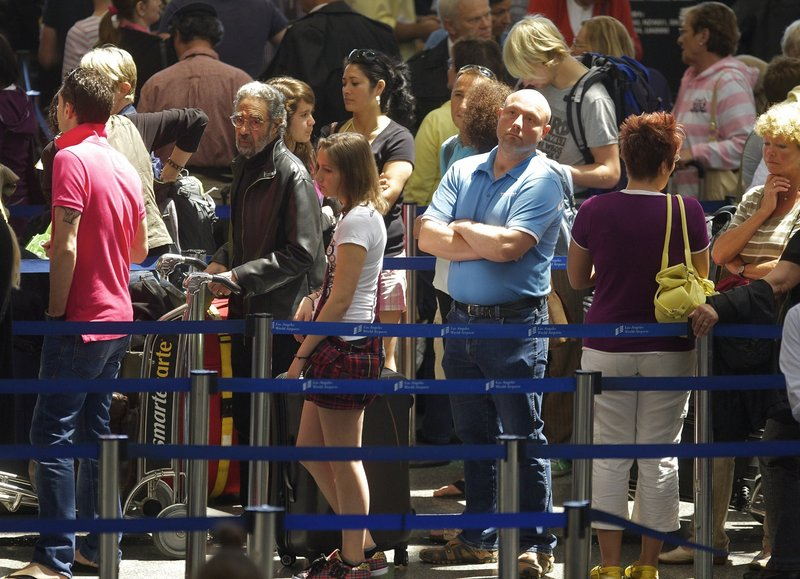 Passengers at Los Angeles International Airport wait to check in Monday for British Airways flights to Europe. The airspace over some of England might be reopened today, but the zone might not extend to London due to a new volcanic ash cloud spreading east from Iceland.