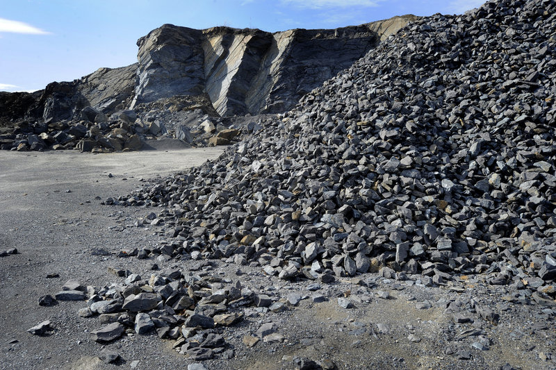 Crushed rock awaits use as rip-rap and other road construction applications.