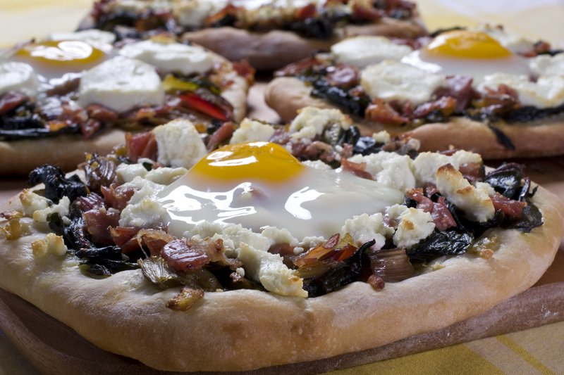Egg on pizza can be delicious if the white cooks but the yolk remains runny, creating a sort of sauce.