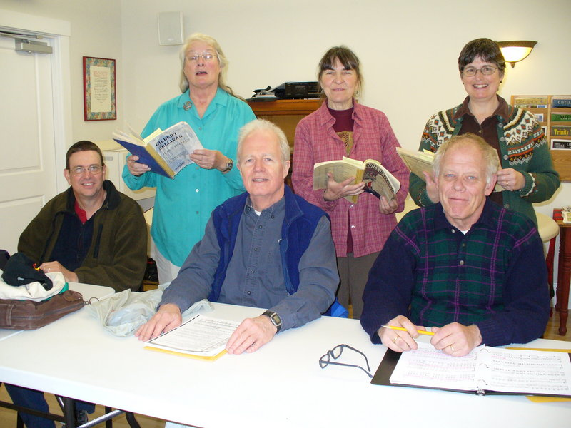 Savoyard Sing chorus members rehearsing are, from the left, in front, Rick Gatewood, John Chase and Peter Clain. In back are Judy Rock, Jean Goldfine and Sandy Hall.