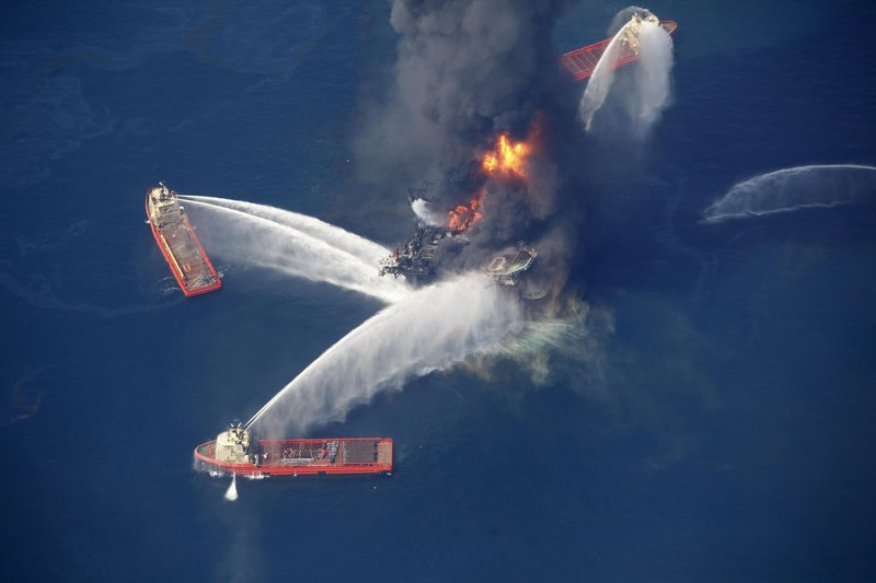 Water cannons take aim at fires burning aboard the Deepwater Horizons oil rig 50 miles southeast of Venice, La., in the Gulf of Mexico on Wednesday. Crews were recovering many of the 126 workers on the rig while also searching for 11 missing workers.