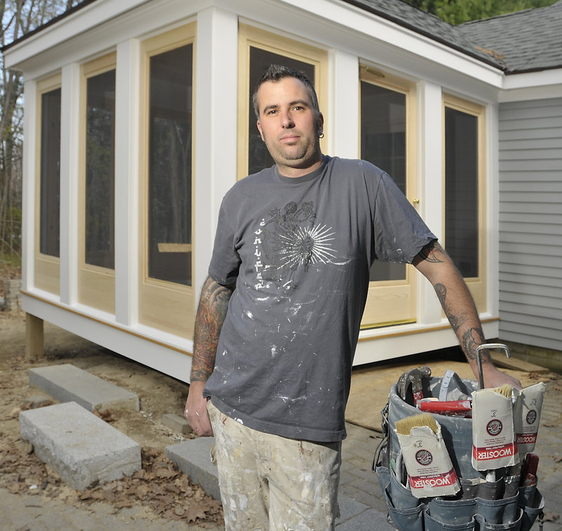 Anthony D'Agostino, owner of Custom House Painting and Restoration, takes a break Thursday while working on a home in Yarmouth. He says he favors strict laws on lead-safe practices, but the new regulations try to do too much.