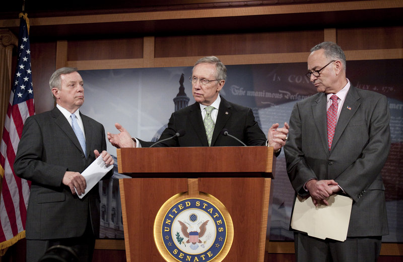 Senate Majority Whip Richard Durbin, D-Ill., left, and Sen. Chuck Schumer, D-N.Y., right, listen Thursday as Senate Majority Leader Harry Reid, D-Nev., discusses financial regulatory reform at a news conference on Capitol Hill.