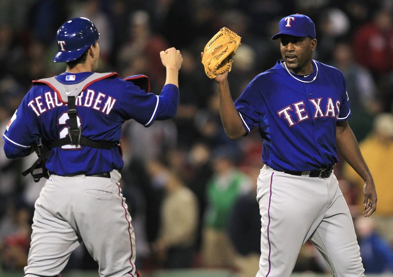 Texas Rangers pitcher Darren Oliver, right, is congratulated by catcher Taylor Teagarden after Oliver earned his first save since 1994 on Thursday night in Boston.