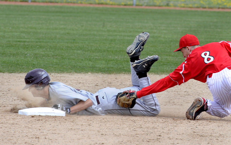 Steve Broy of Gorham slides safely into second with a stolen base Friday as Paul Reny of South Portland makes the late tag. It came during South Portland's 9-0 victory in a Telegram League opener at Wainwright Field in South Portland.