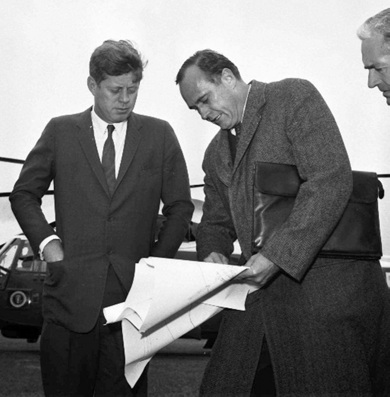 In this 1963 photo, President John F. Kennedy, left, discusses drawings with architect John Warnecke as they look over a possible site for a library to house his public papers near Harvard University in Cambridge, Mass.