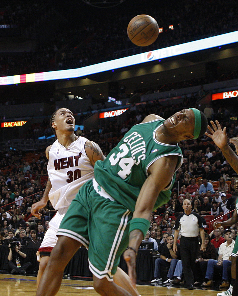 Paul Pierce of the Boston Celtics loses the ball on a drive Friday night, but later hit the winning shot to beat the Miami Heat, 100-98.