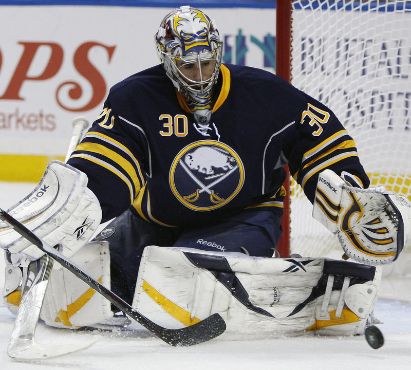 Ryan Miller makes one of his 34 saves for the Sabres Friday night in a 4-1 win over the Bruins at Buffalo, N.Y. The first-round series returns to Boston for Game 6 on Monday, with the Bruins leading 3-2.