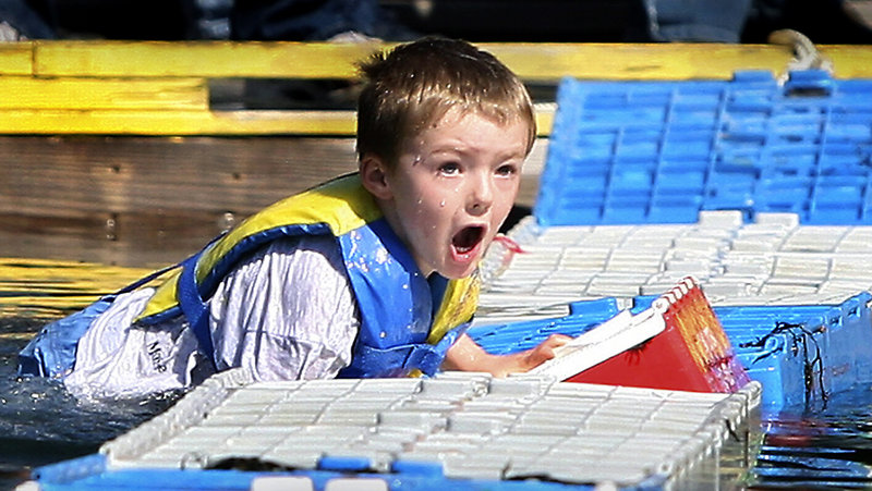 Corbin Drake, 5, made it across six crates before falling into the water during the lobster crate-running competition.