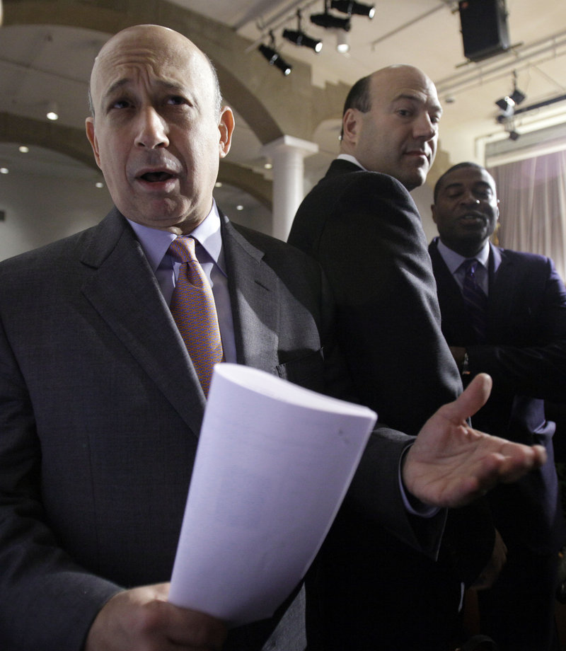 A Senate panel released e-mails Saturday that it says show that Goldman Sachs, headed by CEO Lloyd Blankfein, left, exploited the plunge in housing prices.