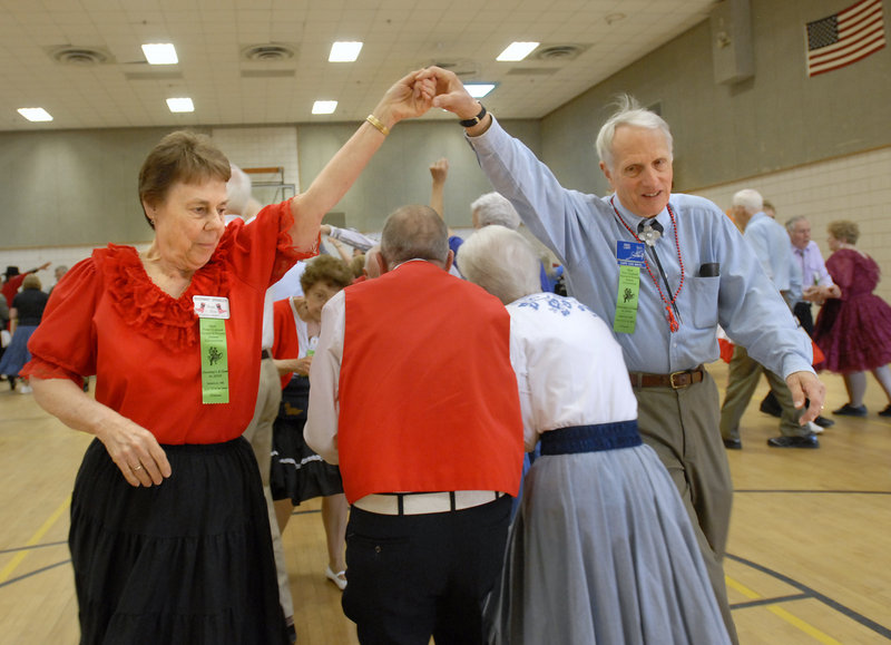 Rosemary Spengler of LaGrange, N.Y., and Dave Light of Cape Cod, Mass., make a bridge for their partners during the New England Square and Round Dance Convention.