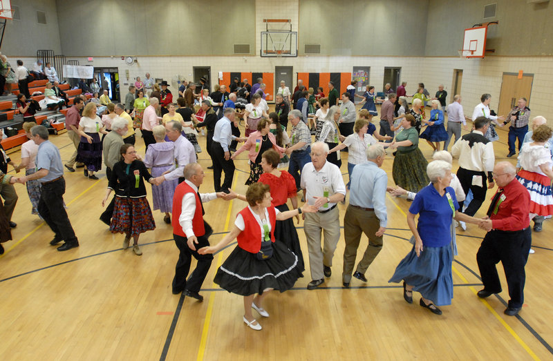 Participants hit the floor at the New England Square and Round Dance Convention in the Biddeford Intermediate School gym Saturday. Running counter to the trend of falling participation is a Brunswick-based club that does round dancing, like the waltz.