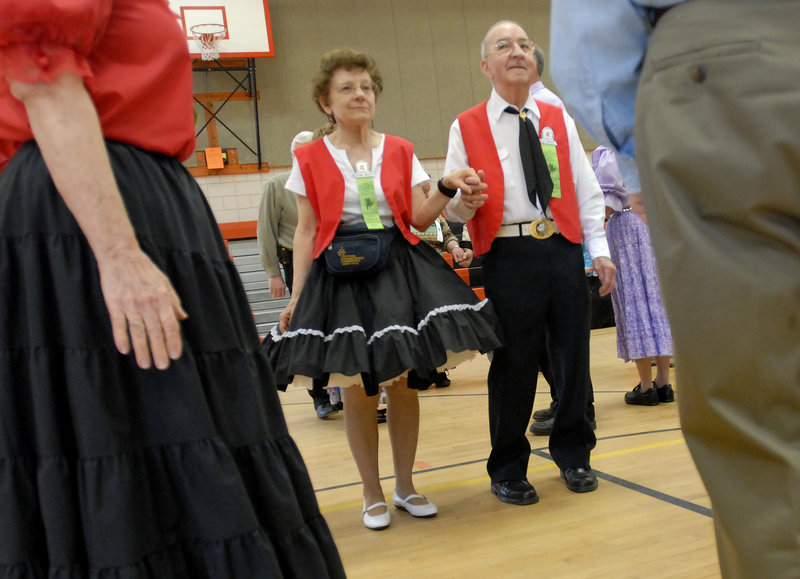 Leo and Josephine Thibodeau of Waterbury, Conn., line up with dance partners during the 52nd annual New England Square and Round Dance Convention in Biddeford.