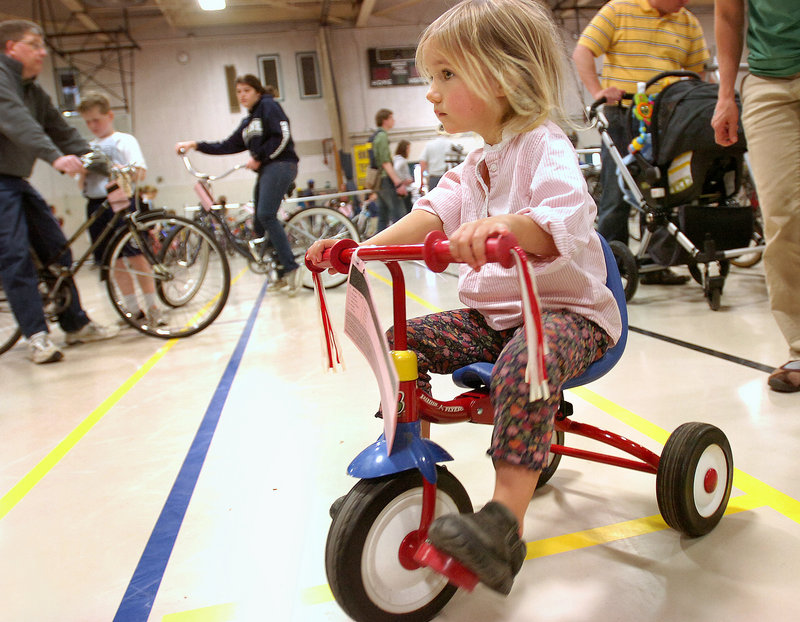 Elaina Floge, 2, of Whitefield tests a tricycle.