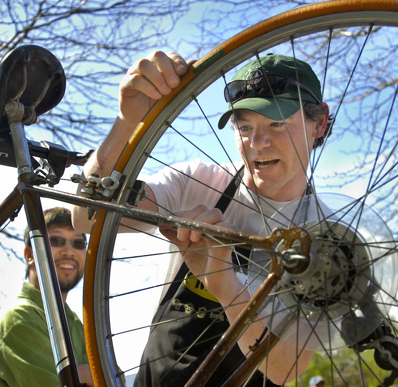Brian Danz of Gorham Bike and Ski checks the condition of a bike for Roy Ghim of Portland, left.