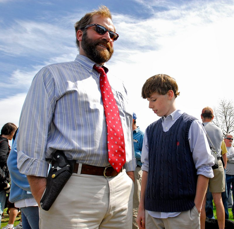 Charlie Carter of Bath attends the open-carry gathering with his son Felix, 11.