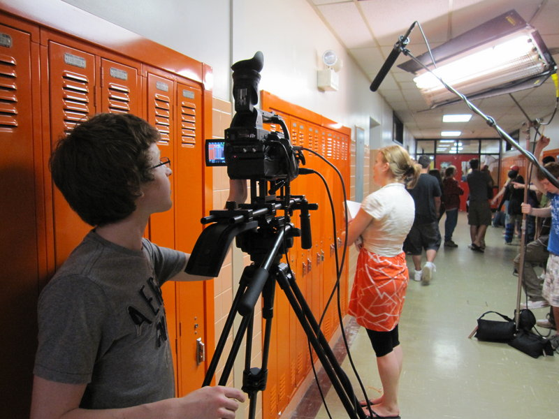 Student cameraman Patrick Higgins films a scene featuring fellow student Gwendolyn Benoit in the Sanford High School hallway. Benoit plays one of the main characters in the as-yet untitled movie.