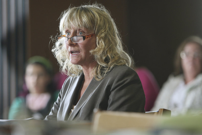 Marie Veselsky of Plymouth, N.H., who has spent eight months on antibiotics for Lyme disease, testifies before a state Senate panel Monday in favor of a bill to allow long-term antibiotic treatment for Lyme disease without board disciplinary action.