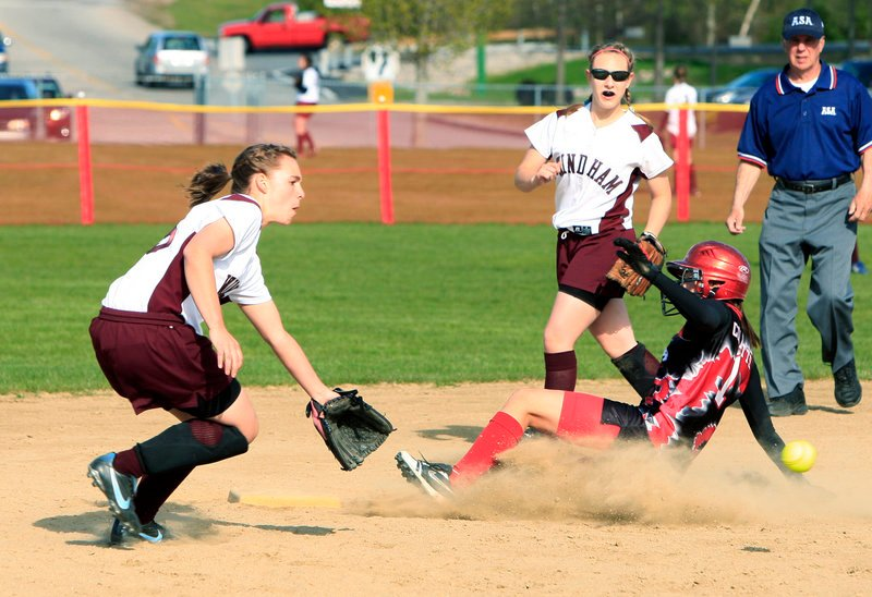 Jenn Colpitts of Scarborough slides safely into second base as Windham shortstop Nicole Kennedy waits for the throw Monday in an SMAA softball game at Scarborough. Colpitts had three of her team's 14 hits in a 13-1 win.