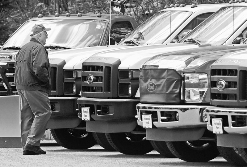 Walter Arbuckle of Braintree, Vt., looks over Ford F-150 pickup trucks at the Formula Ford dealership in Montpelier.