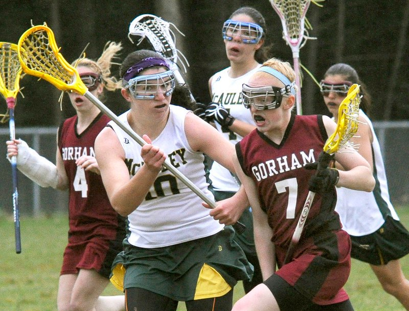 Shannon Wilcox of Gorham attempts to get past Michele Girard of McAuley during their girls' lacrosse game Tuesday. Mia Rapolla scored nine goals as Gorham earned a 17-7 victory in an opener at McAuley High.