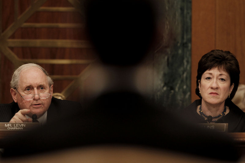 Senate Investigations subcommittee Chairman Sen. Carl Levin, D-Mich., left, and Sen. Susan Collins, R-Maine, question Goldman Sachs executives on the firm's role in the global financial crisis at a hearing Tuesday on Capitol Hill in Washington.
