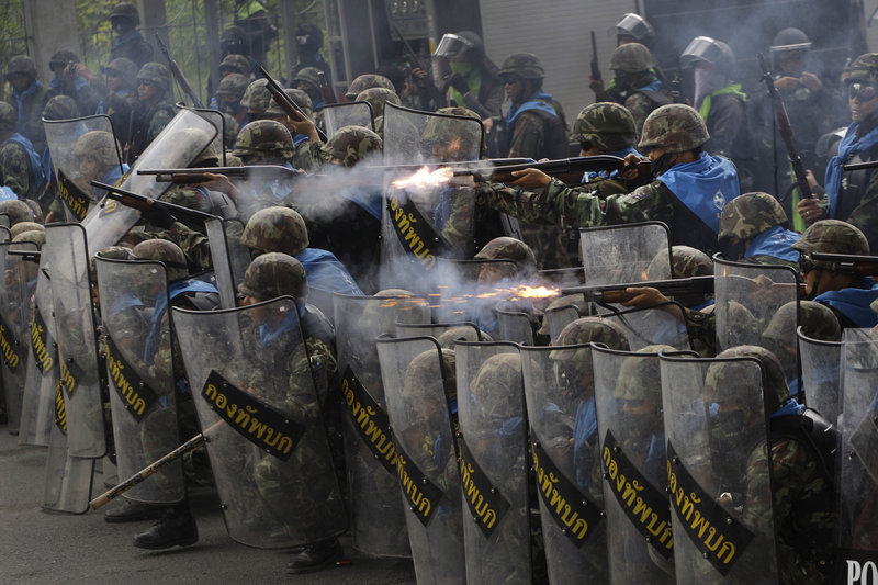 Thai soldiers fire on anti-government protesters during clashes near Bangkok, Thailand, on Wednesday as they tried to keep the Red Shirts from expanding their demonstrations from a base in the capital.